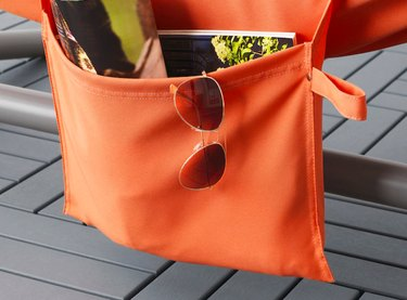 orange hammock pocket with sunglasses and magazines