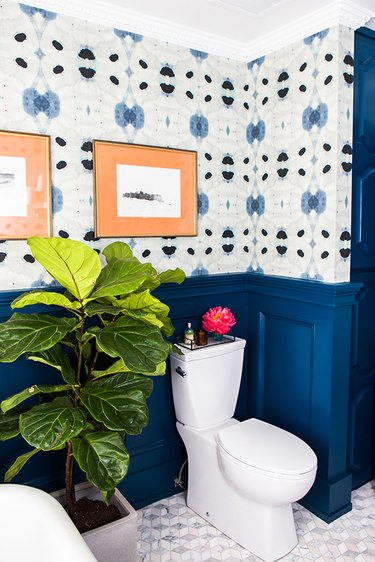 bathroom wainscoting idea with patterned wallpaper