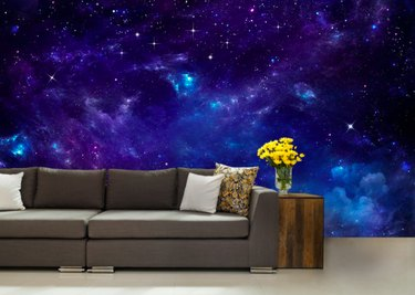 Couch with side table yellow flowers and space wallpaper