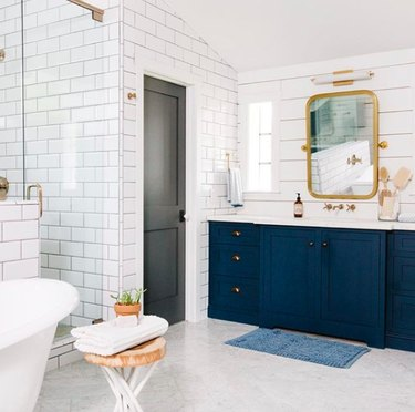 Navy Blue and Gold Create a Stunning Bathroom Design