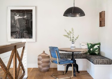 Kitchen nook idea with blue vinyl chair at a small round table in a modern dining nook