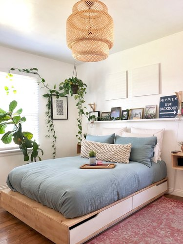 bedroom rug ideas with an area rug and woven pendant light