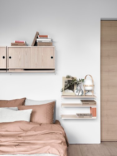 Bedroom shelving idea for modern pink bedroom