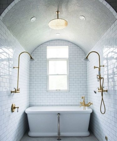 traditional bathroom idea with all-over tiled white bathroom