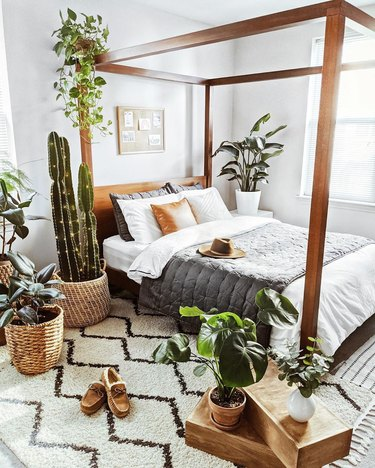 masculine boho bedroom surrounded by indoor plants