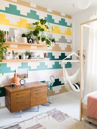 Bedroom shelving idea with patterned accent wall