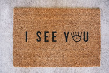 "Finished doormat that says ""I See You"""