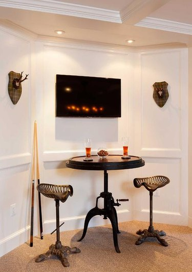 basement man cave ideas with bar stools and mounted antlers