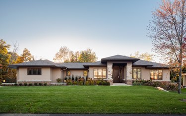 craftsman style ranch house seen from the outside with trees nearby
