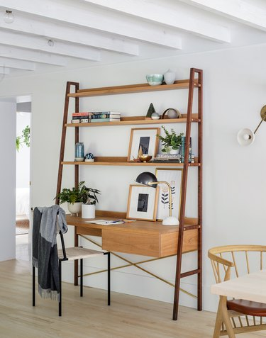 Scandinavia home office setup that includes a singular unit of a desk with shelving