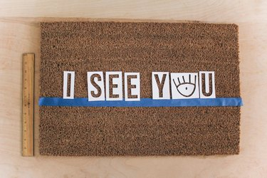 Letter stencils centered on doormat