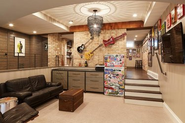 basement man cave ideas with chandelier and mounted guitars