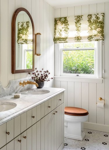 traditional bathroom idea with tongue and groove walls and cabinets, wood accents