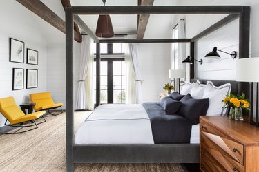 black and white bedroom idea velvet canopy bed and exposed ceiling beams