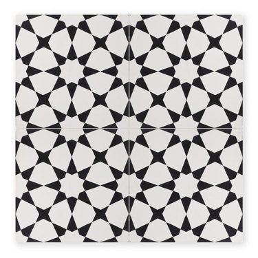 Black and white flower-inspired geometric tile with white being dominant color