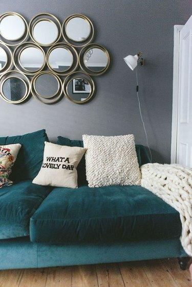 cozy living room wall decor idea with retro mirrors