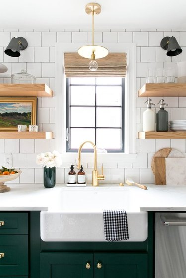 kitchen backsplash idea with white subway tile and open shelving and green cabinets