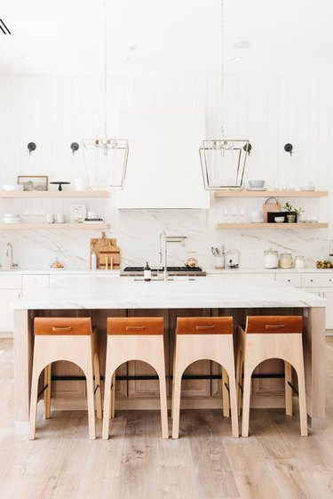 Desert-Themed Kitchen with white cabinets and marble backsplash by Studio McGee