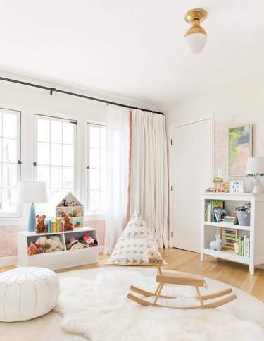 bedroom curtain idea with double lined curtains with fringing in child's bedroom