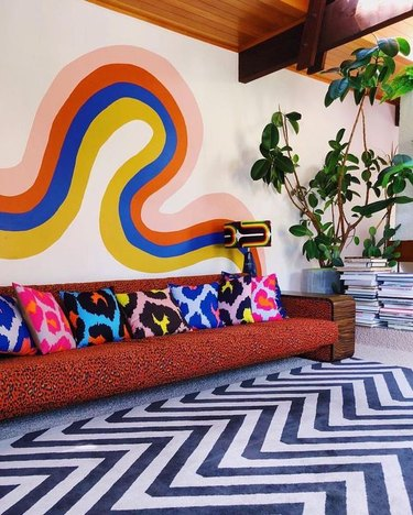 retro living room wall decor idea with abstract painted waves on wall