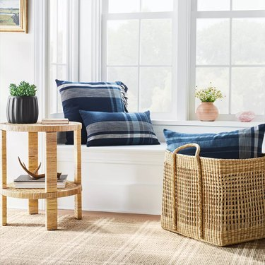 window nook with basket and rattan table nearby
