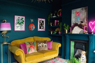 teal color living room with yellow velvet sofa
