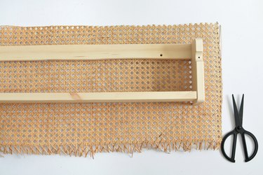 Wooden shelf with cane webbing