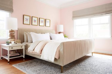 pink traditional bedroom color schemes with beige upholstered bed and roman shades