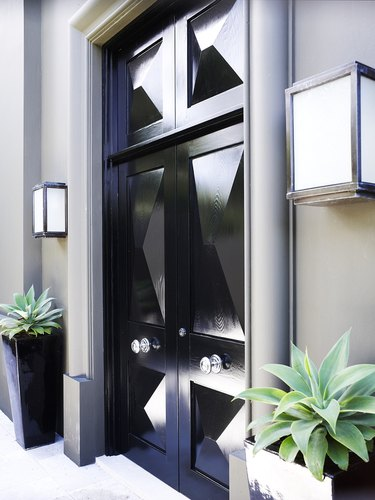 Art deco door in glossy black paint and geometric details