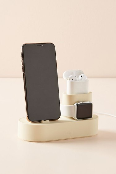 charging station with phone, watch, and headphones