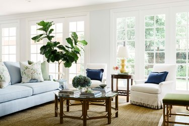 traditional living room with blue sofa and wood coffee table