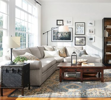 traditional living room with wooden coffee table and sectional sofa