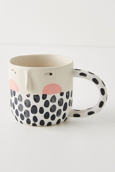 mug with black and white pattern and drawn face