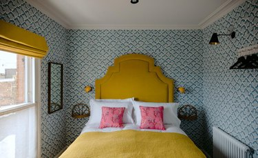 yellow bed in traditional bedroom color schemes with blue wallpaper