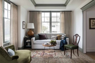 wool family room carpet ideas in family room with green accent chair