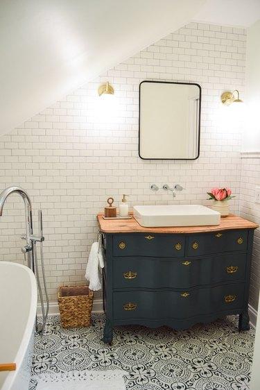 spa bathroom ideas with vintage dresser as vanity cabinet and patterned floor tile
