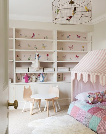 soft pink neutral colors in girl's bedroom with small white table
