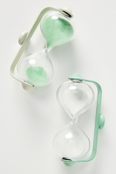 two green hourglasses, one with sands inside