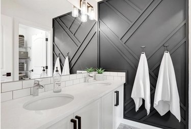 charcoal neutral colors on accent wall in white bathroom