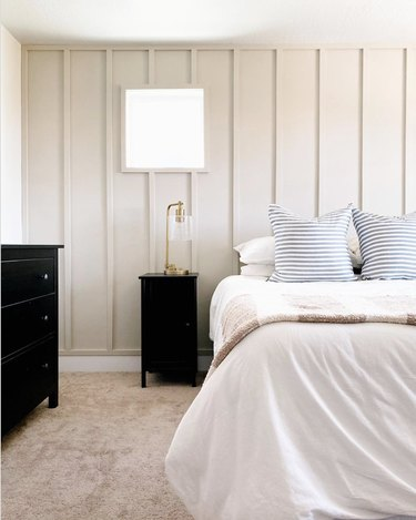 cream neutral colors in bedroom with black nightstand and dresser