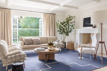 monochrome traditional living room with pop of blue