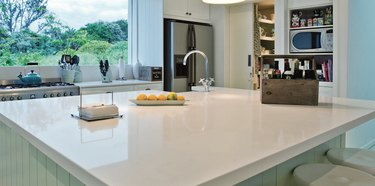Solid white quartz countertop colors, kitchen island, kitchen island sink, built in shelves, picture window.
