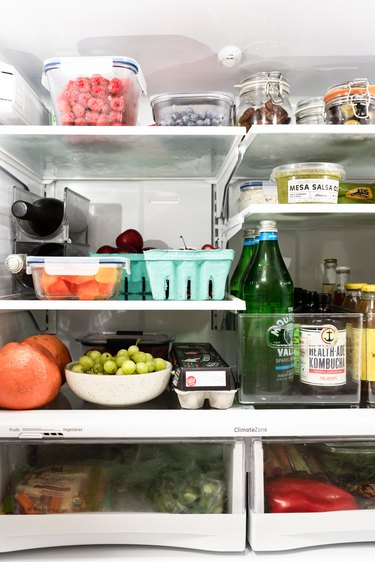 the inside of a refrigerator filled with fresh produce and other groceries