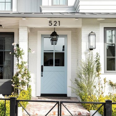 blue farmhouse front door idea with glass inserts