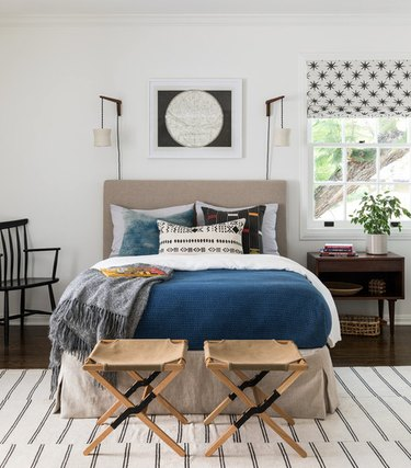 bedroom lighting ideas with vintage hanging wall sconces on either side of headboard