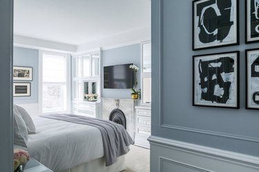 traditional home decor in robins egg blue bedroom with molding on walls and wainscoting