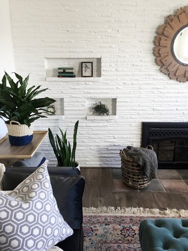 rustic basement ideas with white brick wall and indoor plants