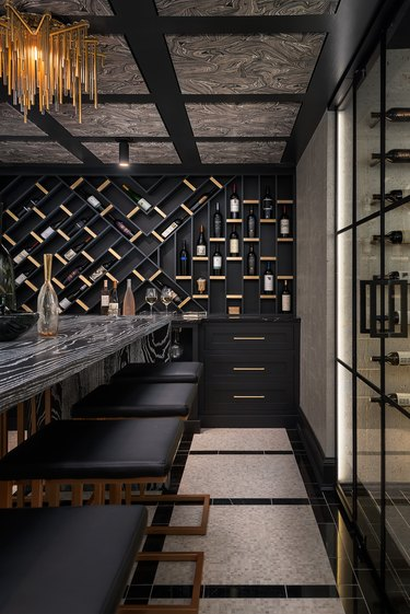 black basement paint colors with wine storage and marble stable