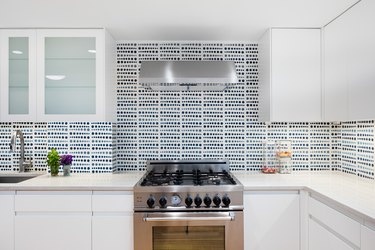 white kitchen with patterned tile backsplash
