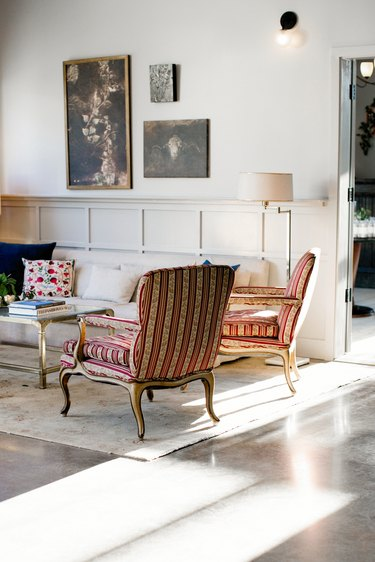 traditional home decor with wall paneling and vintage furniture